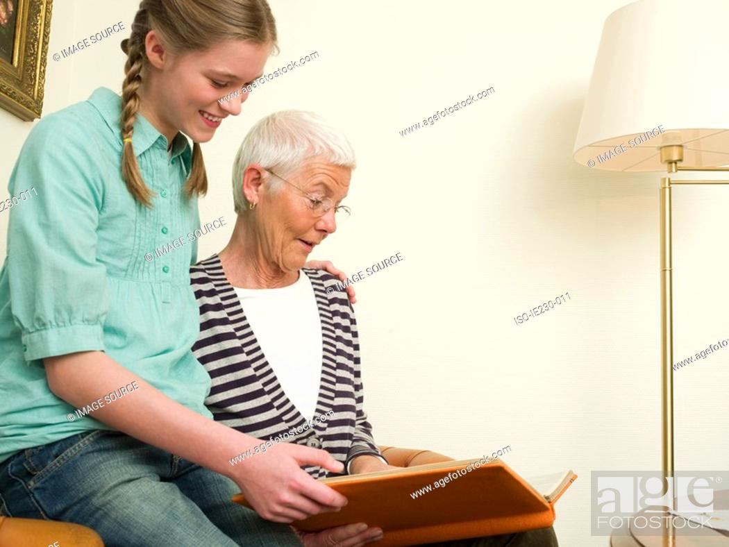 Stock Photo: Grandmother and granddaughter reading.
