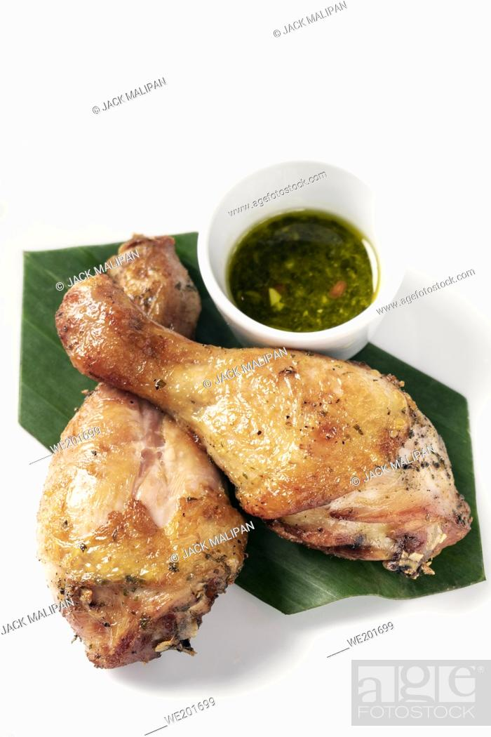 Stock Photo: roast chicken drumsticks appetizer with spicy thai green chilli sauce on white background.