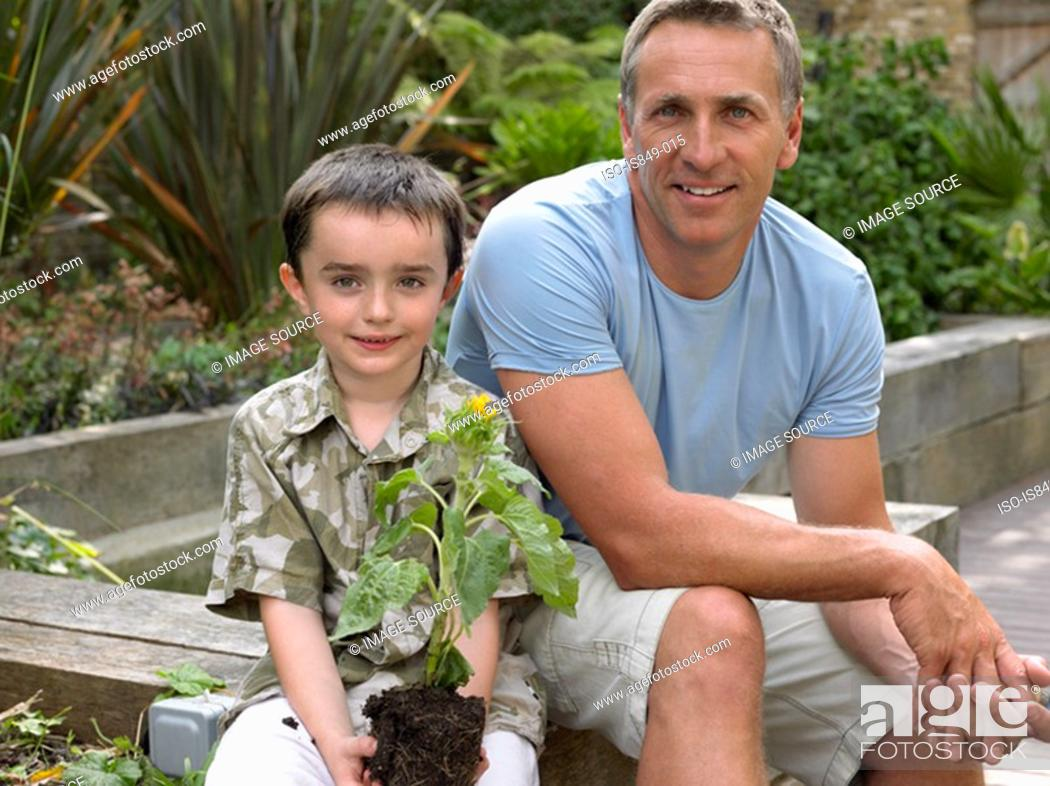 Stock Photo: Father and son in garden.