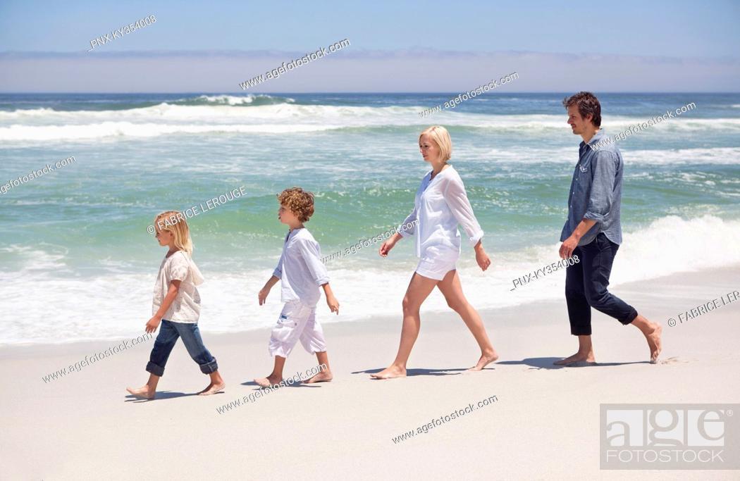 Stock Photo: Family walking on the beach.