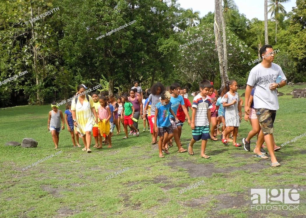 Stock Photo: school children on day trip with teachers, visiting historic sites. Tahiti, French Polynesia.