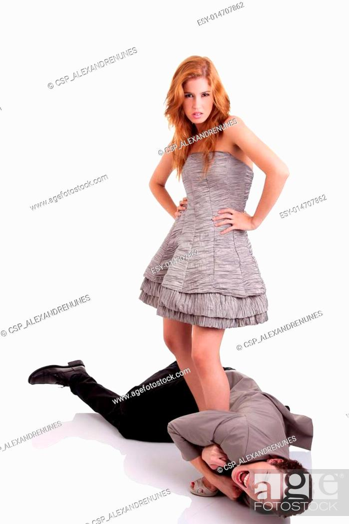 56cb321383 Stock Photo - handsome young man crawling, clinging to the foot of a  beautiful woman, isolated on white, studio shot
