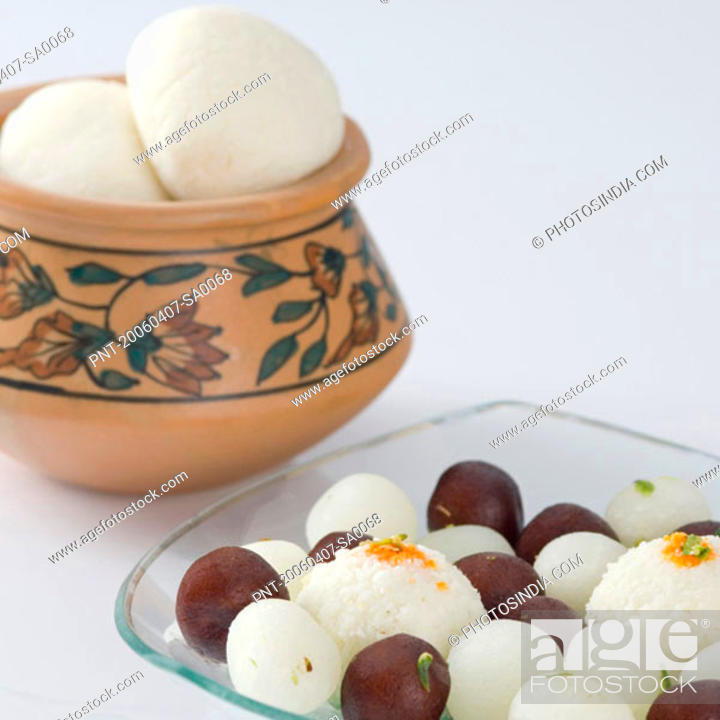 Stock Photo: Rasgullas and Gulab Jamuns in a bowl.