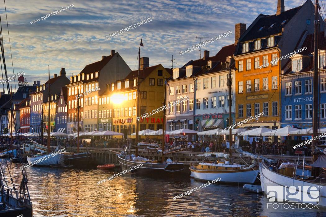 Stock Photo: Nyhavn Canal wooden ships townhouses and alfresco terrace, Nyhavn, Copenhagen, Denmark, Scandinavia. 17th century waterfront district lined by brightly coloured.