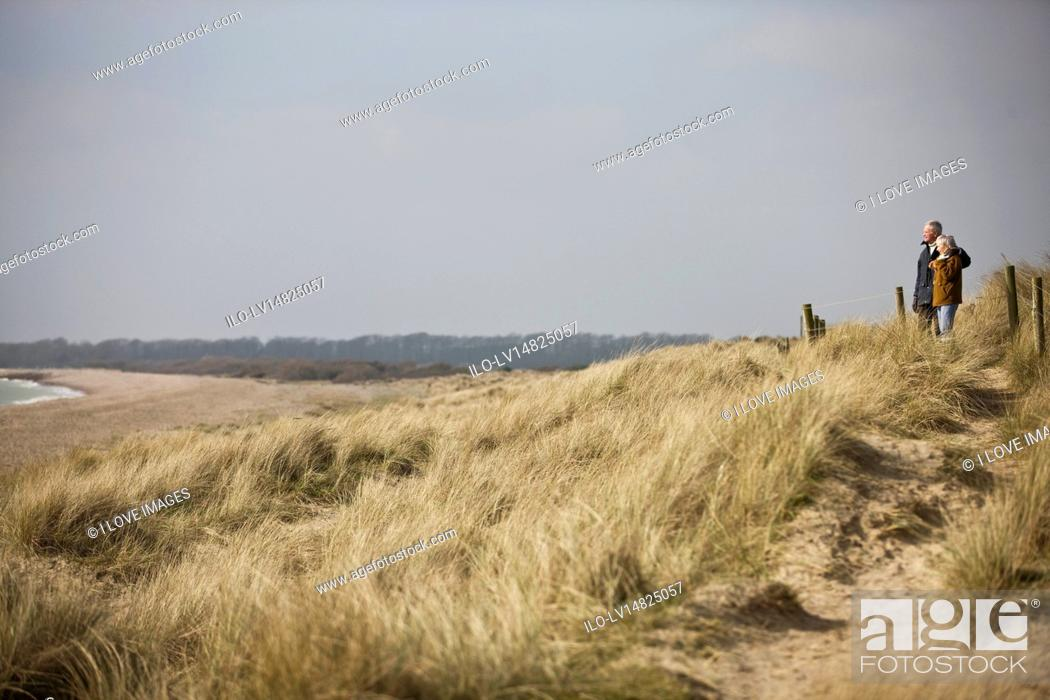 Stock Photo: A senior couple looking out to sea.