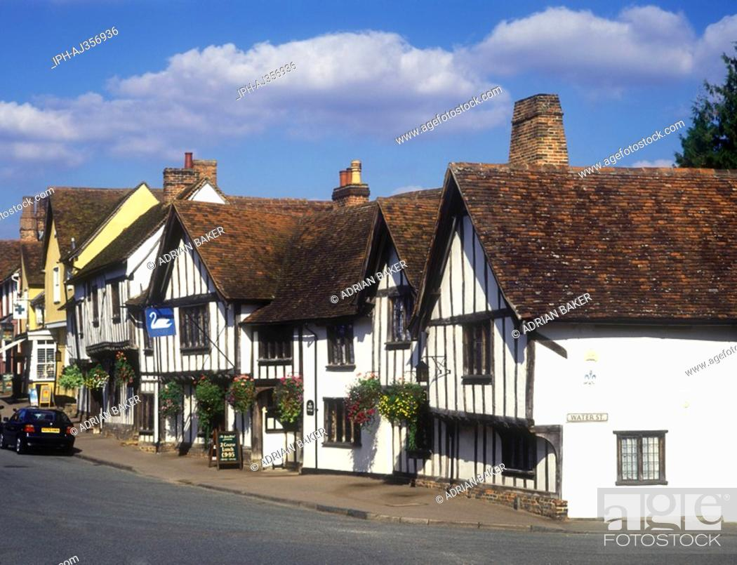 Stock Photo: Street scene in the village of Lavenham showing the Swan Hotel, a medieval half-timbered building.