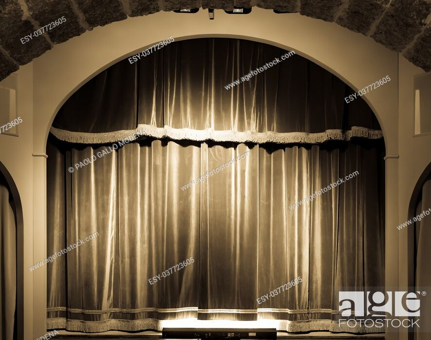 Stock Photo: A red curtain in an old and very small Italian theatre.