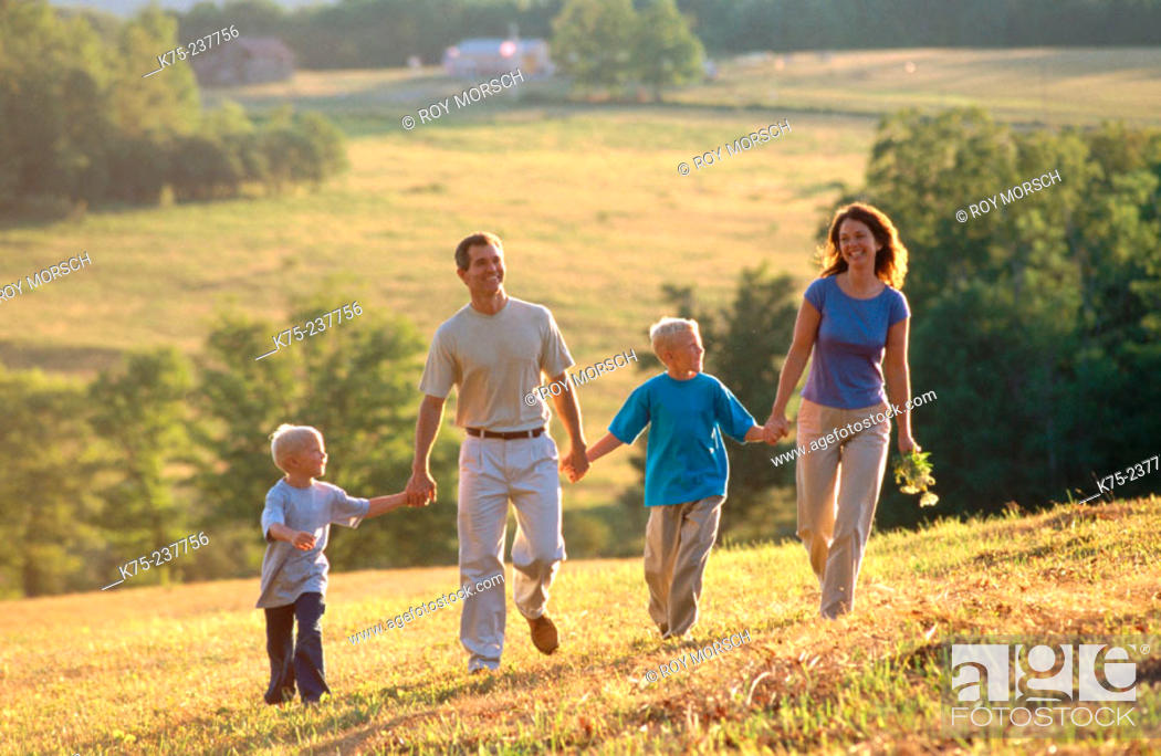 Stock Photo: Family walking in country.