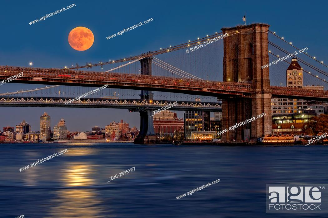 Stock Photo: Super Moon Over Manhattan and Brooklyn Bridges NYC - A view to the Brooklyn and Manhattan Bridges from Manhattan with the super moon rising and it's bright.