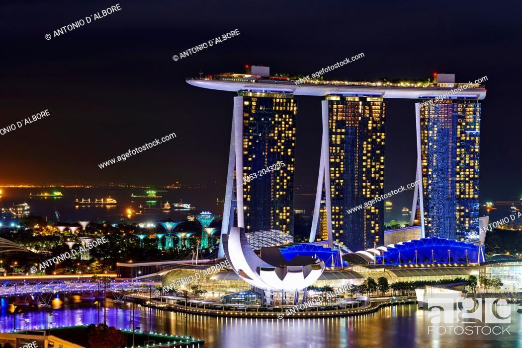 Stock Photo: Aerial night view of Marina Bay Sand, a luxury complex that include hotel, casino, exhibition centre and a shopping mall. Singapore.