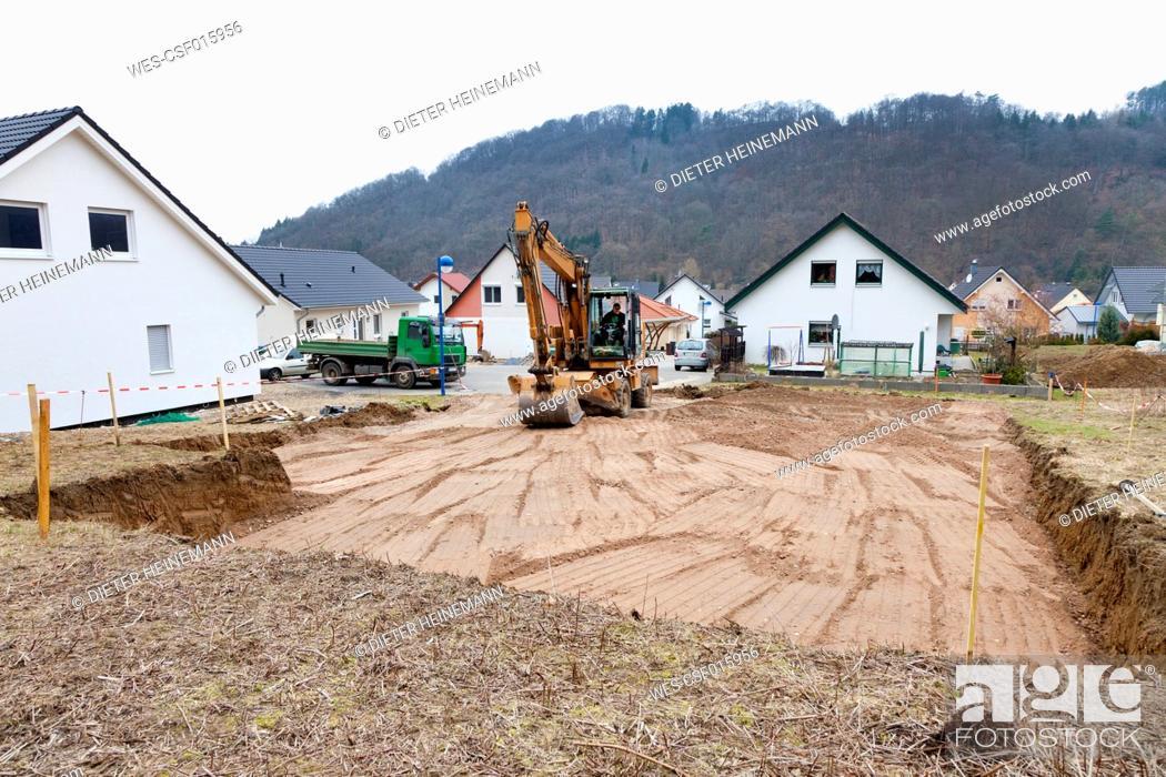 Stock Photo: Europe, Germany, Rhineland Palatinate, Man preparing ground for house foundation.