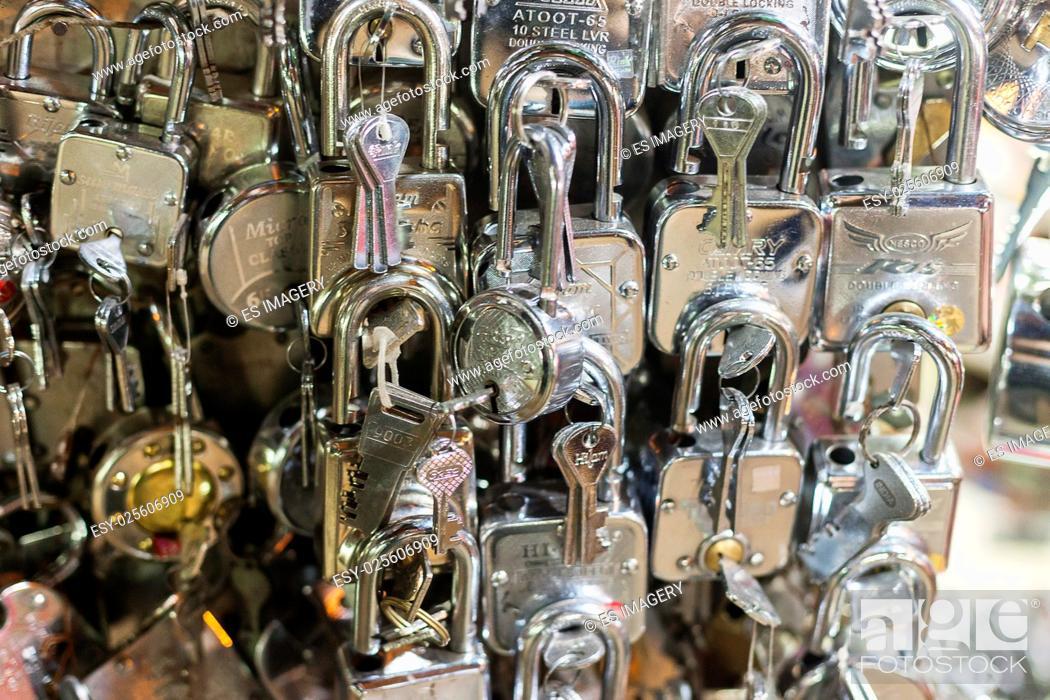 Stock Photo: Shiny silver locks on display at a street market.