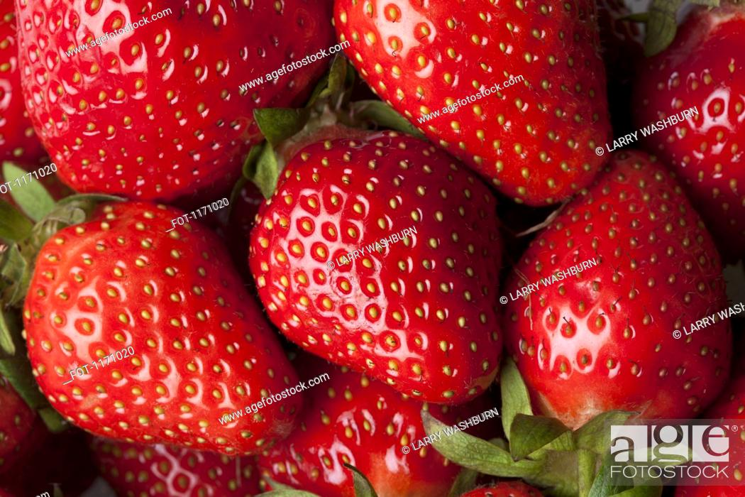 Stock Photo: A heap of strawberries, full frame.