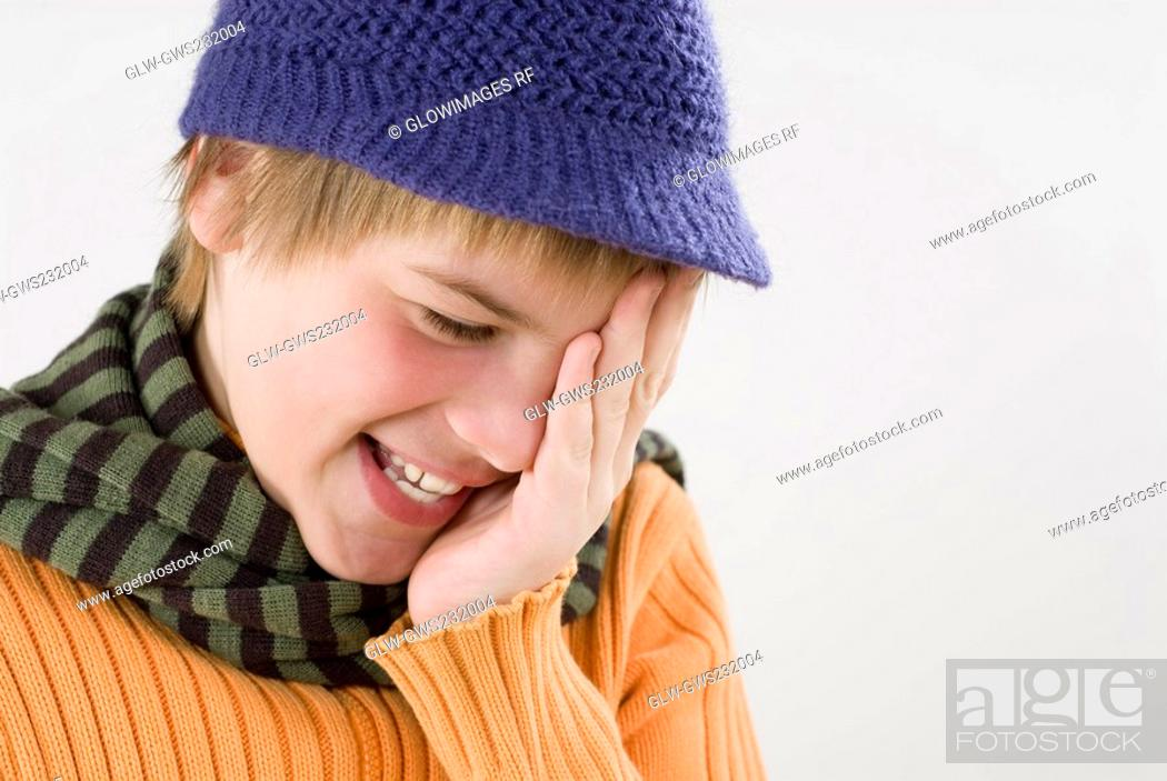 Stock Photo: Close-up of a boy covering his eyes with his hands.