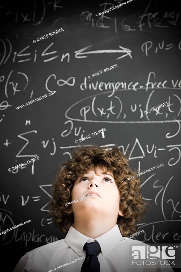 Stock Photo: Boy and blackboard.