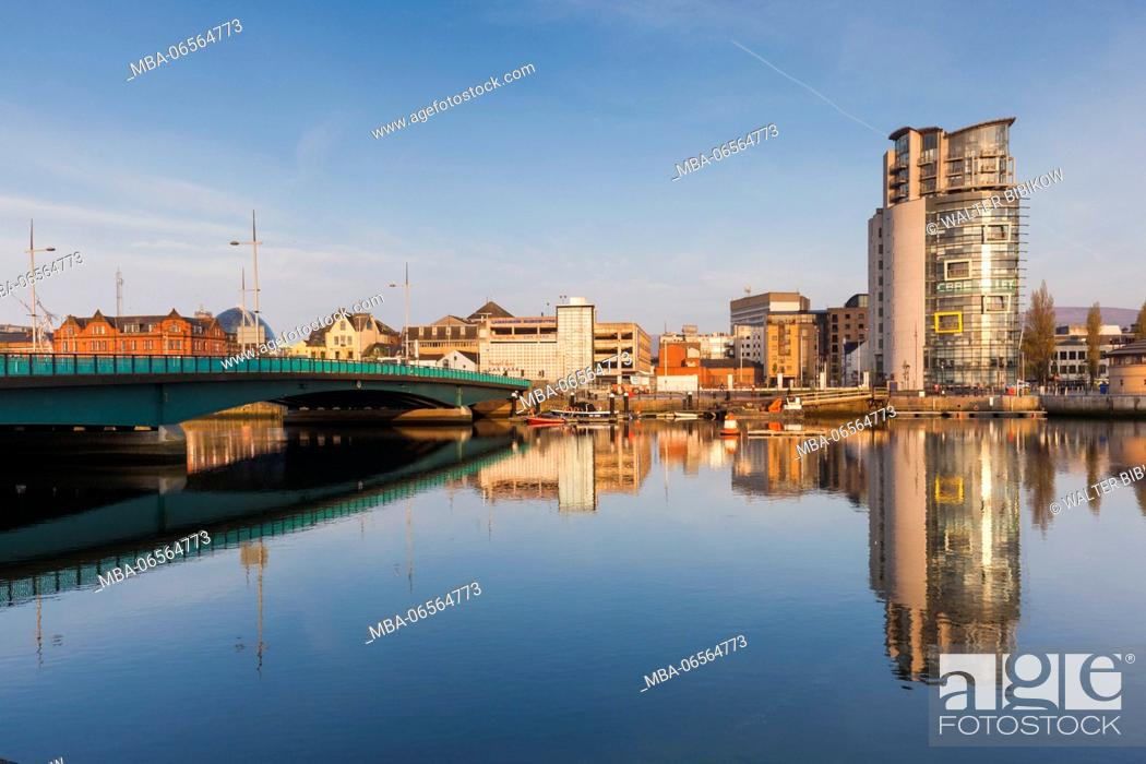 Stock Photo: UK, Northern Ireland, Belfast, city skyline along River Lagan, dawn.