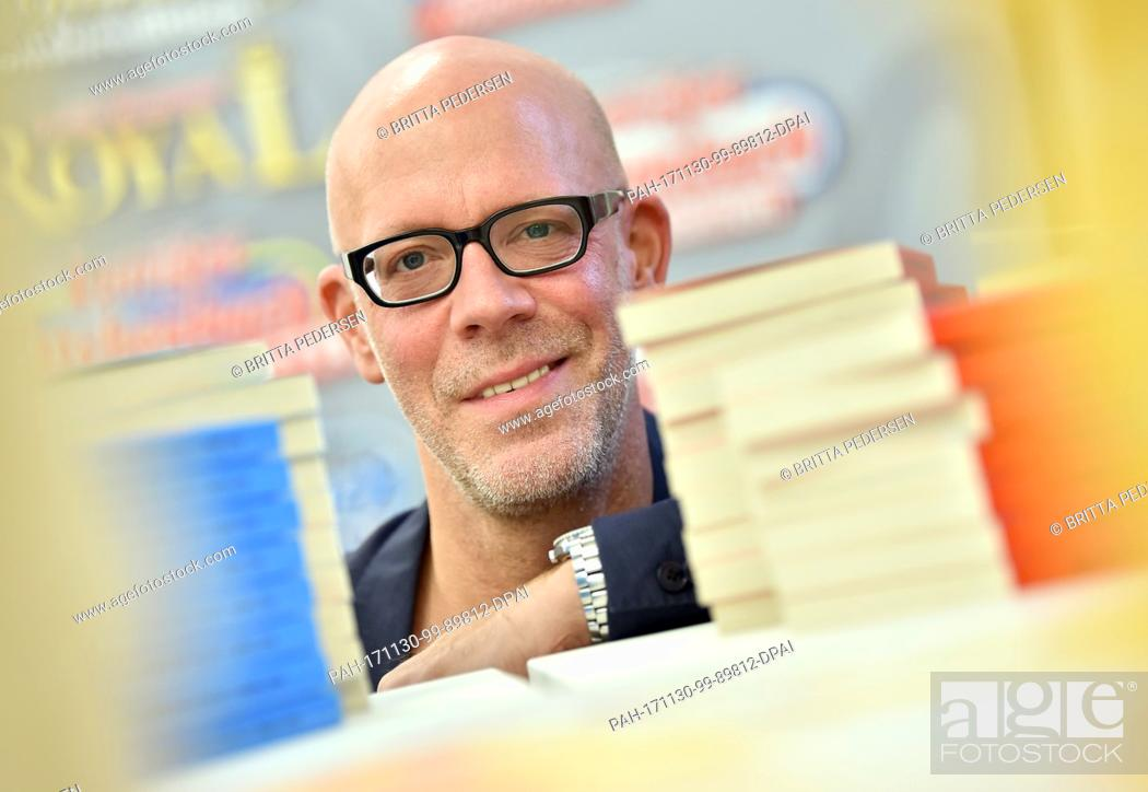 Stock Photo: Peter Hoepfner, editor-in-chief of the Egmont Ehapa publishing company in Germany, poses at the LTB pop-up store in Berlin, Germany, 30 November 2017.
