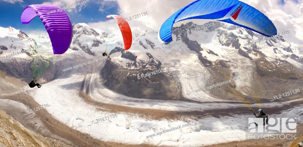 Stock Photo: Paragliders over the Gornergletscher glacier viewed from Gornergrat. Zermatt .