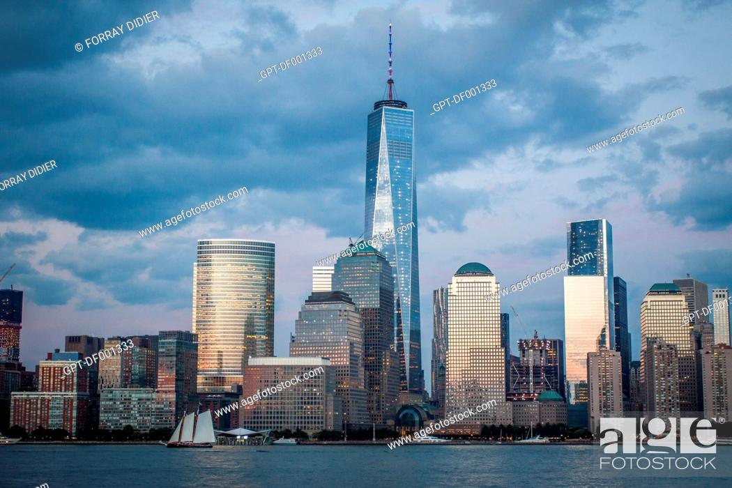 Stock Photo: BLUE HOUR OVER THE SKYLINE OF THE FINANCIAL DISTRICT OF NEW YORK WITH ONE WORLD TRADE CENTER DOMINATING THE CITYSCAPE, VIEW FROM JERSEY CITY, MANHATTAN.