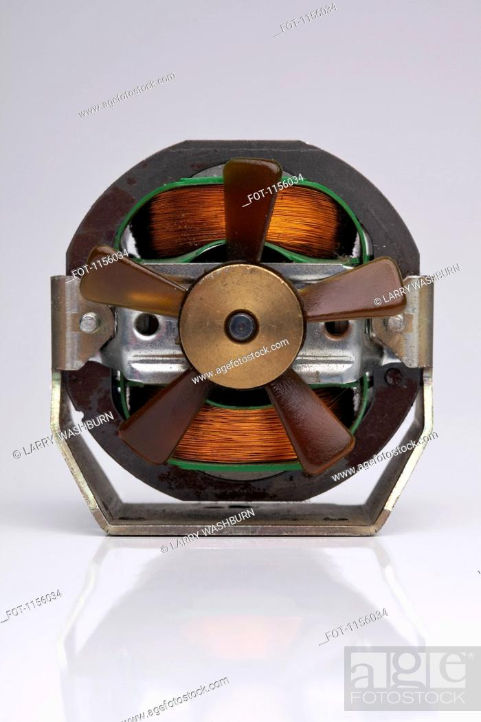 Stock Photo: An electromagnetic coil with fan blades.