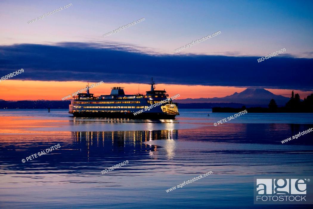 Stock Photo: Ferry on Puget Sound at sunset, Bainbridge, Washington, United States.