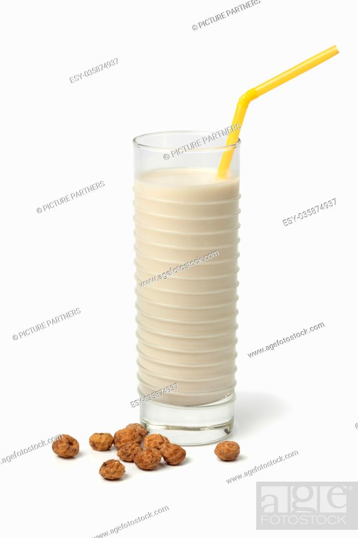 Photo de stock: Glass Horchata milk and shelled chufa nuts on white background.