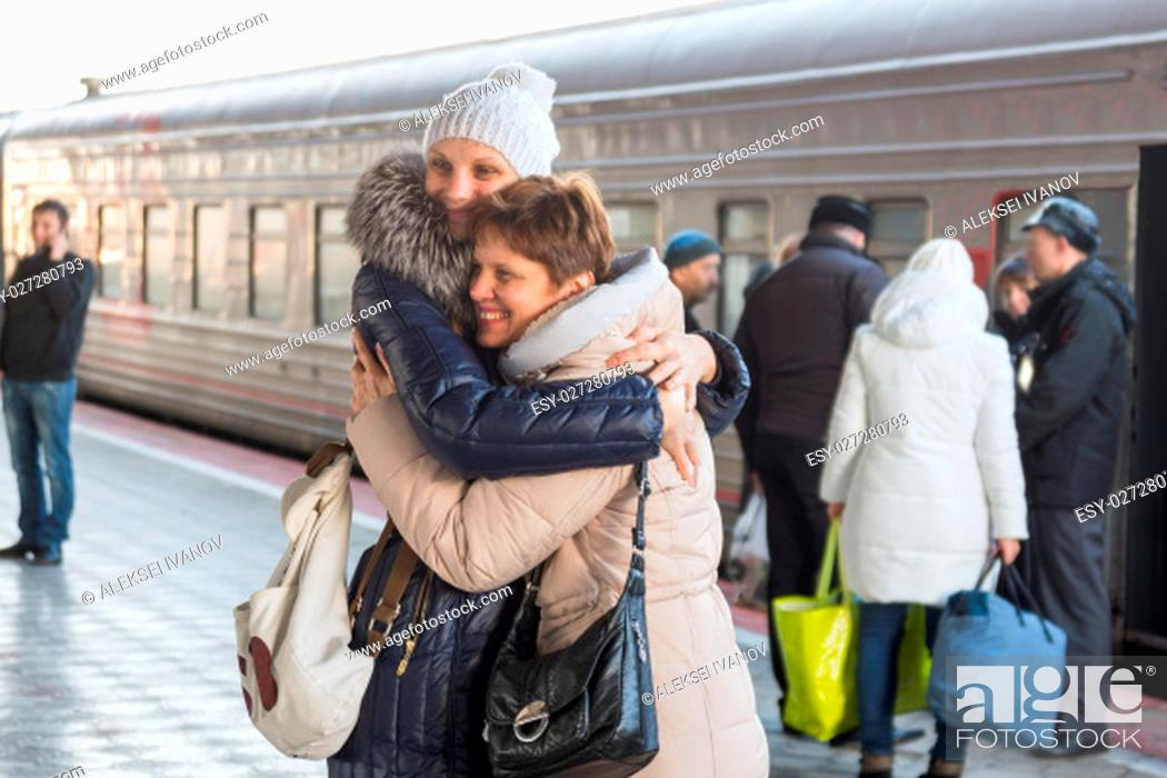 Stock Photo: Adult daughter met my mother at the train at the station.