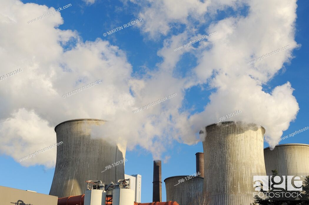 Stock Photo: Coal fired power station Niederaussem emitting steam and smoke from cooling tower and smokestack, close up  Emissions by coal fired power stations are regarded.