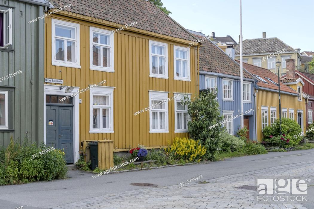 Stock Photo: cityscape with old yellow and blue picturesque traditional houses, shot under bright morning light at Trondheim, Norway.