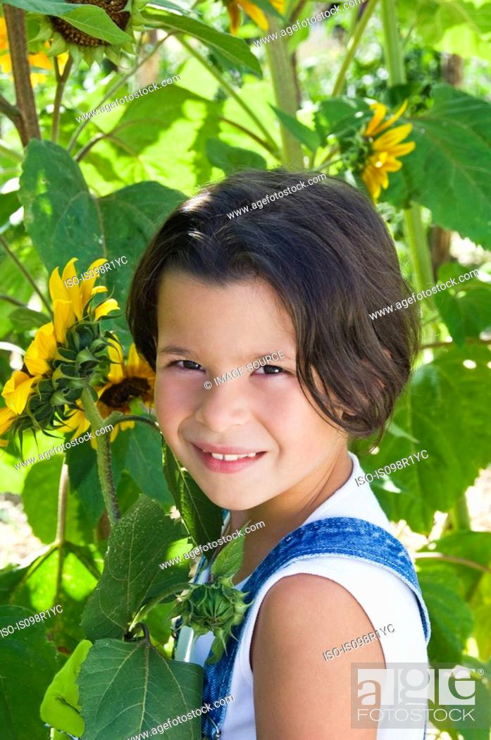 Stock Photo: Girl and sunflowers.