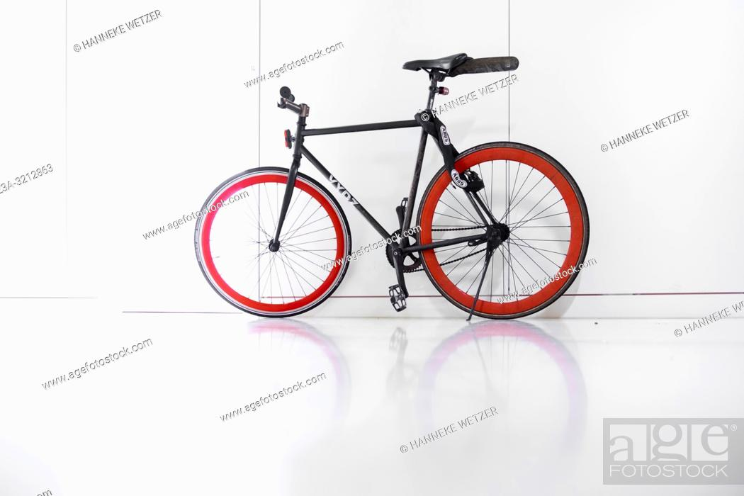 Stock Photo: Bicycle parked in the white interior of building Anton, Strijp-S, Eindhoven, The Netherlands, Europe.