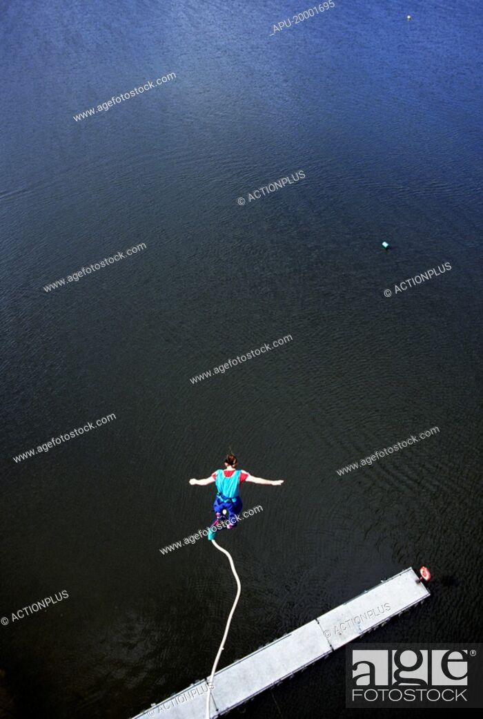 Stock Photo: Bungee jumping over water.