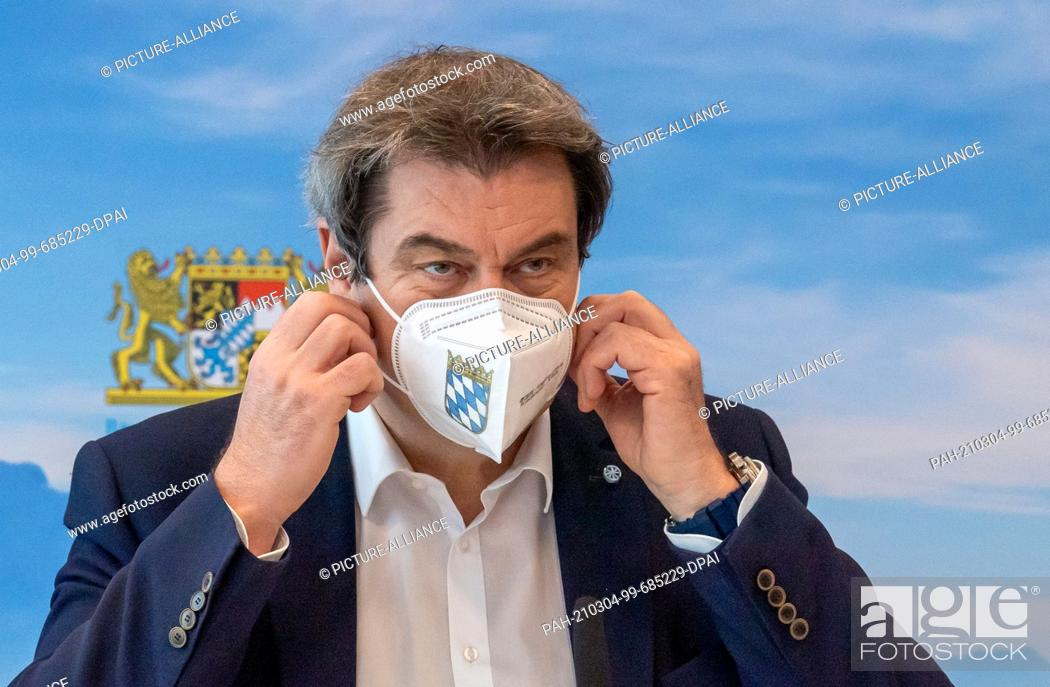 Imagen: 04 March 2021, Bavaria, Munich: Markus Söder (CSU), Minister-President of Bavaria, takes off his protective mask at the beginning of the meeting of the Bavarian.