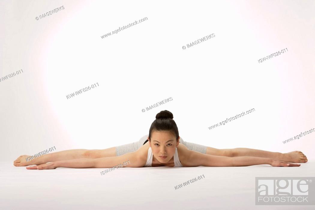 Stock Photo: View of a young woman exercising on the floor.