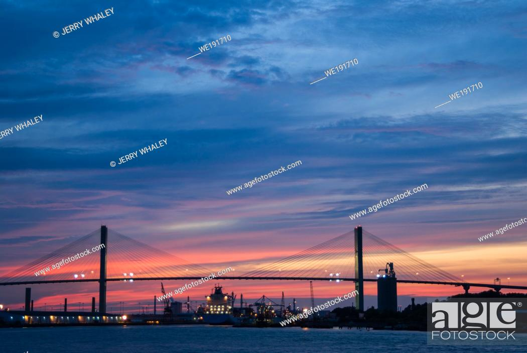 Stock Photo: Container Ship Arriving at Sunset in Savannah, Georgia.