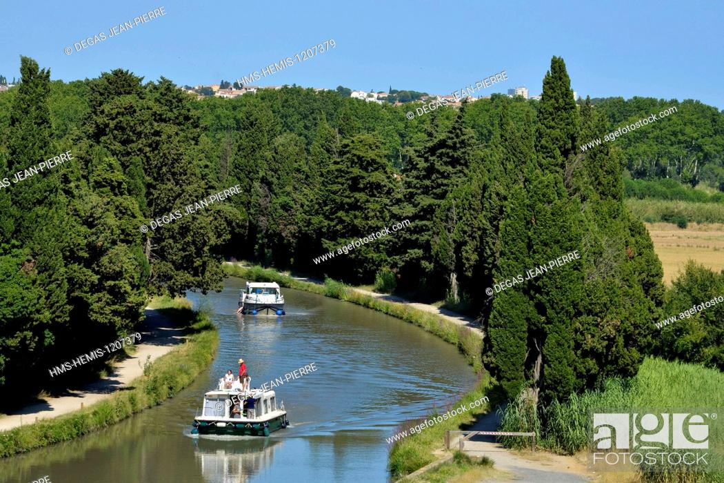Stock Photo: France, Herault, Beziers, Canal du Midi listed as World Heritage by UNESCO, pleasure boats downstream to the locks of Fonseranes in the middle of cypress.