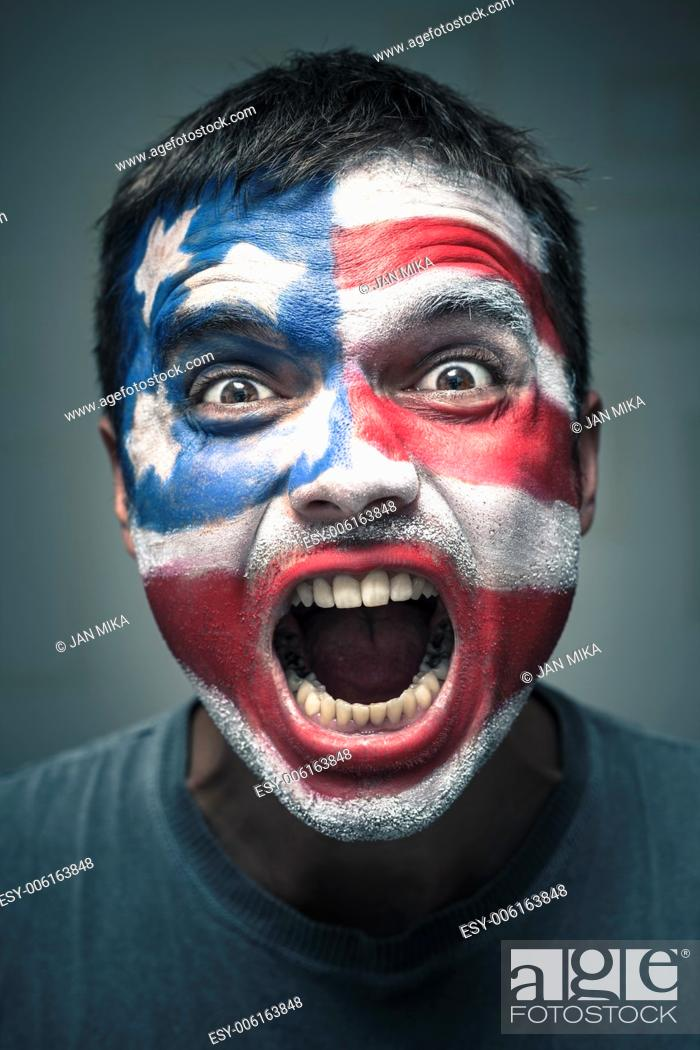 Stock Photo: Portrait of angry man with USA flag painted on face.