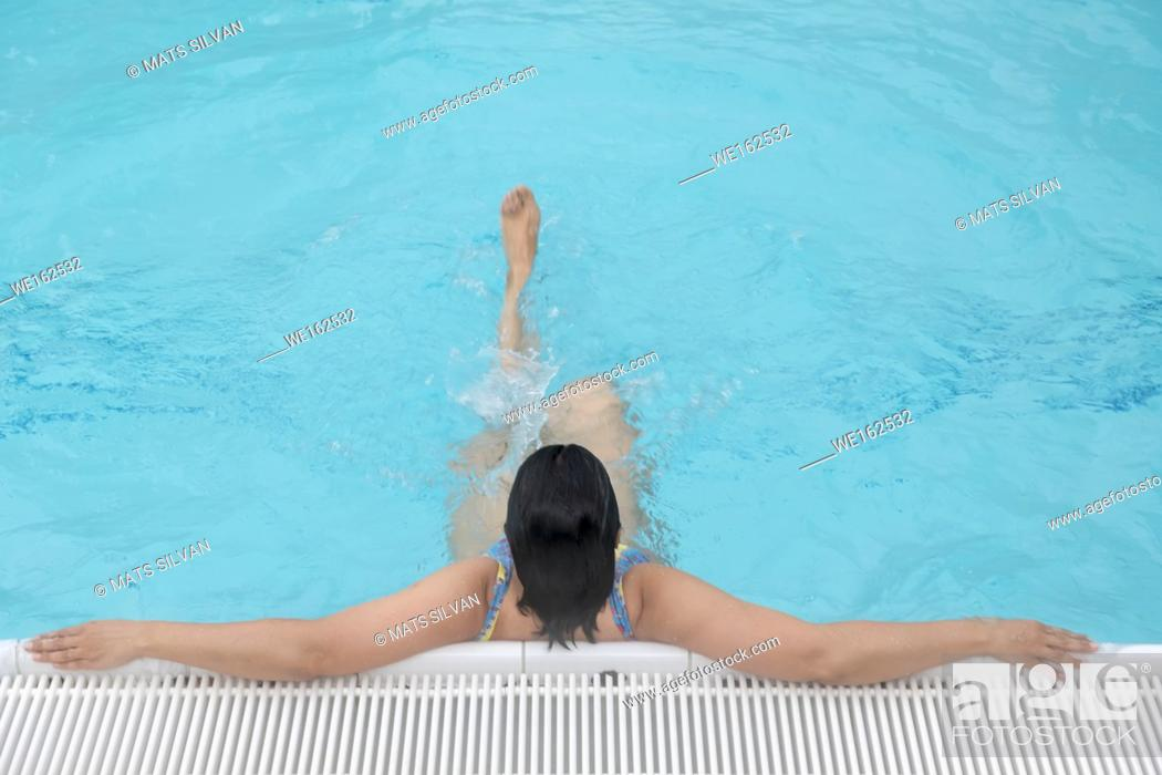 Stock Photo: Woman Relax on the Poolside in Switzerland.