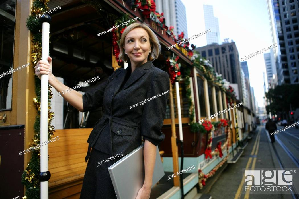 Stock Photo: Mature business woman on a trolley.