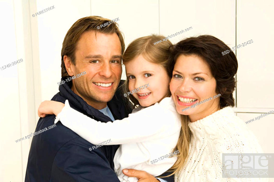 Stock Photo: Portrait of a girl smiling with her parents.