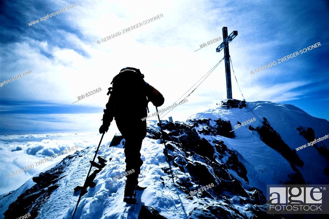 Stock Photo: Mountain climber on the way to the peak, reaching the summit of Mt. Similaun, Tyrol, Austria, Europe.