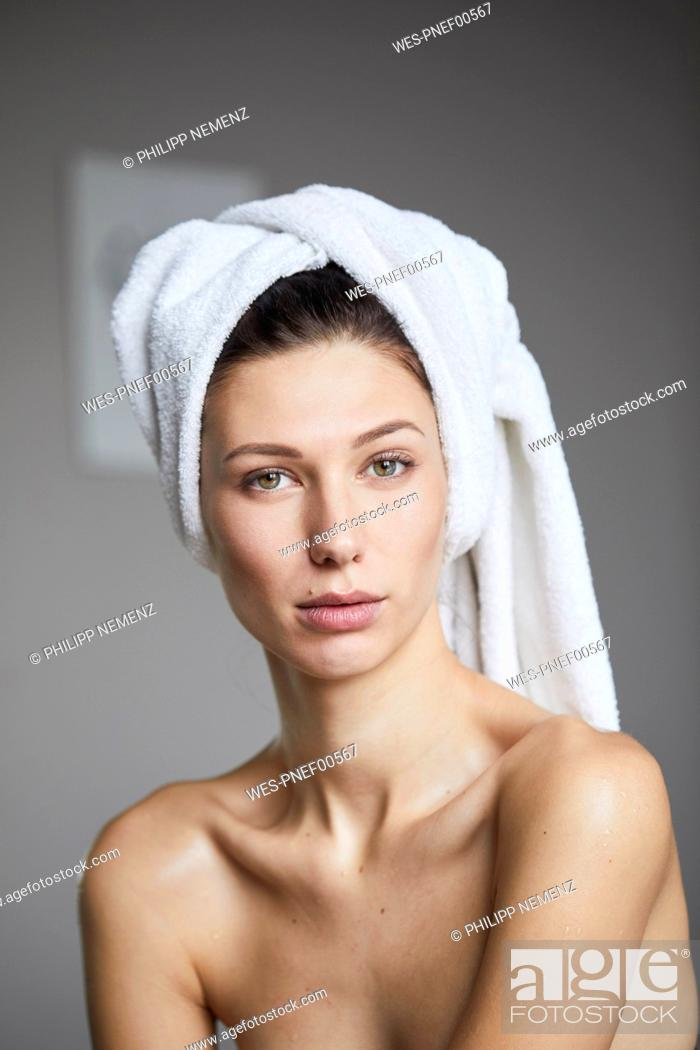 Stock Photo: Portrait of young woman with towel around her head.