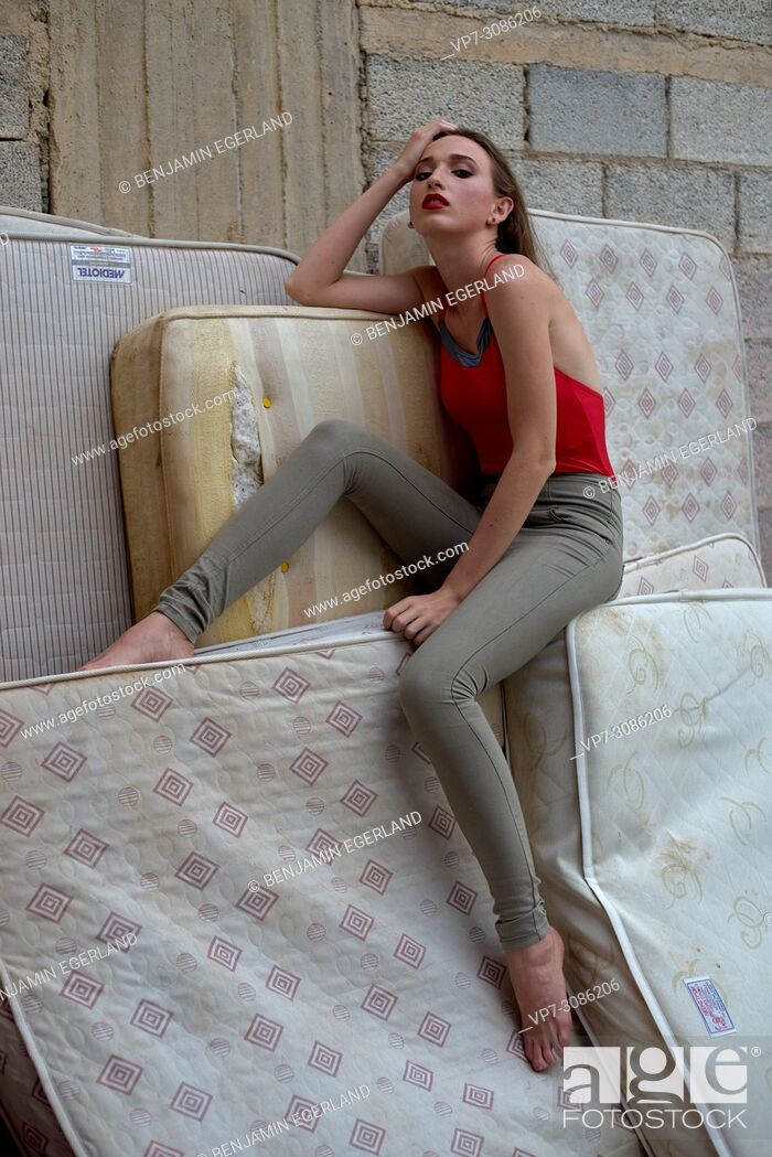 Stock Photo: model woman sitting on mattresses, thoughtful, tired, sensual, exhausted.