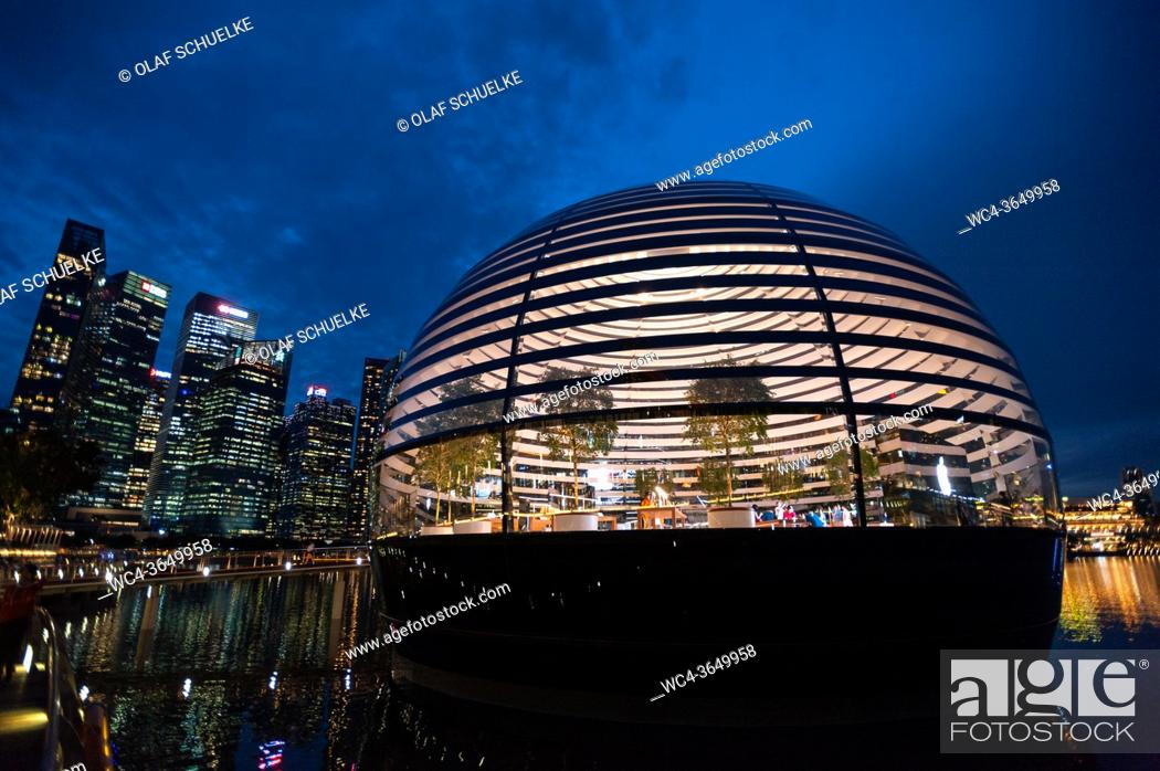 Stock Photo: Singapore, Republic of Singapore, Asia - View of the new Apple Flagship Store along the waterfront at Marina Bay Sands with the city skyline of the central.