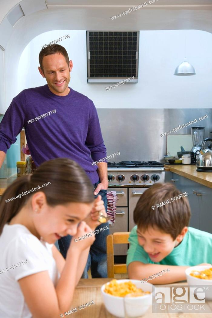 Stock Photo: Family laughing at breakfast.