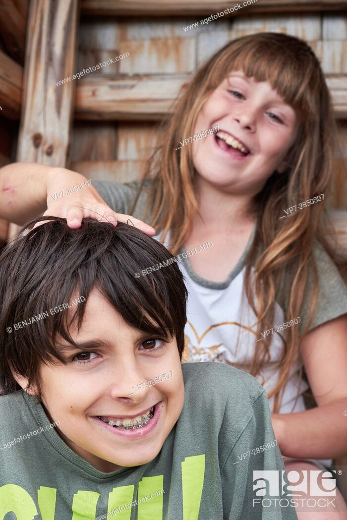 Stock Photo: Two happy bantering children playing while enjoying their friendship and togetherness.