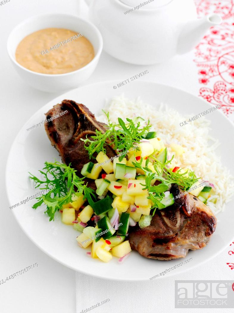 Stock Photo: Plate of meat with chopped vegetables.