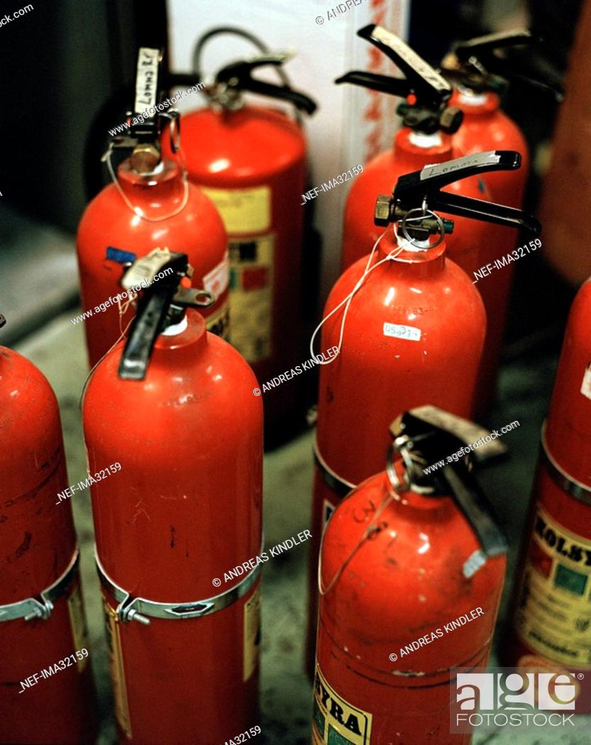 Stock Photo: A number of fire-extinguishers.