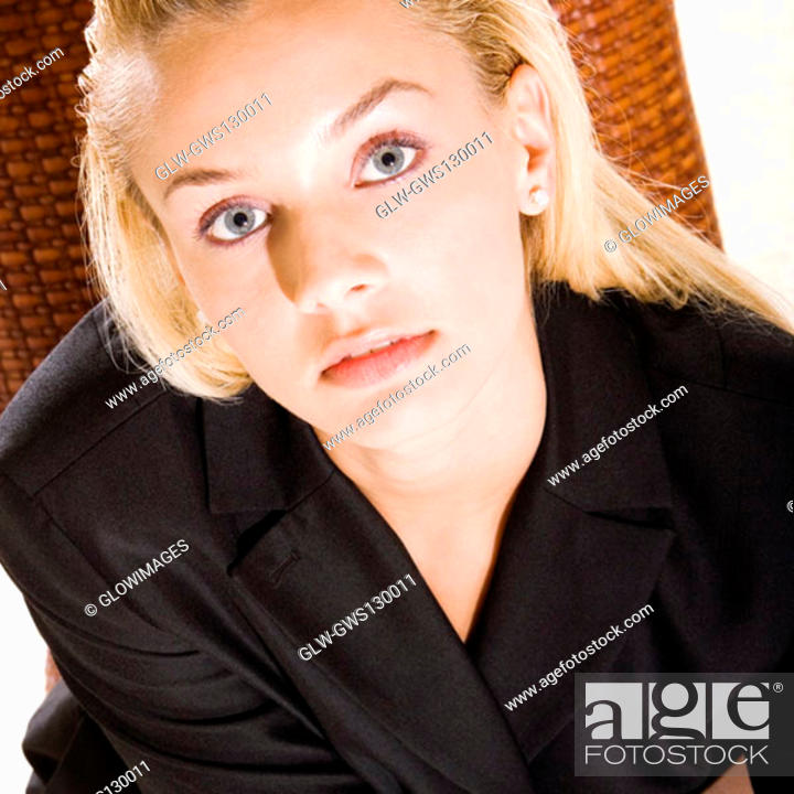 Stock Photo: Portrait of a young woman looking up.