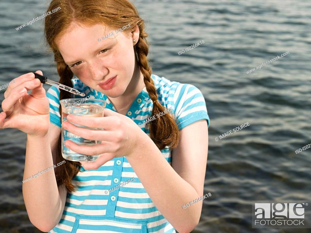 Stock Photo: A girl doing an experiment.